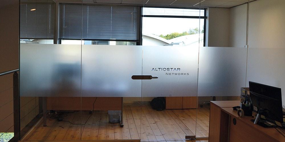 Altiostar – Full-Height Frameless Glass Partitioning with Doors