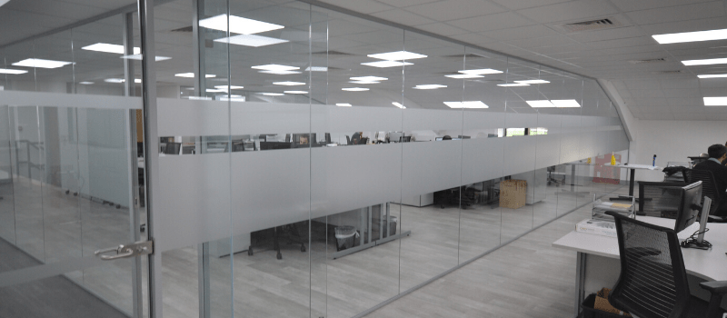 A modern-looking glass partition, showing the benefits of office partitioning